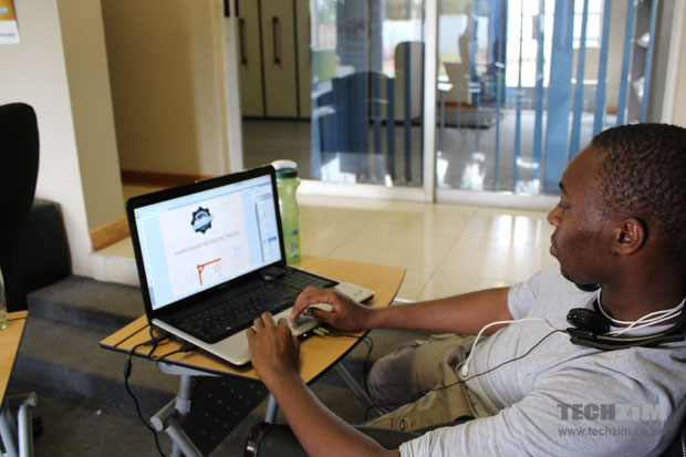 Shepherd  Chabata, who was doing graphics work for iDzodzo, works at his machine.