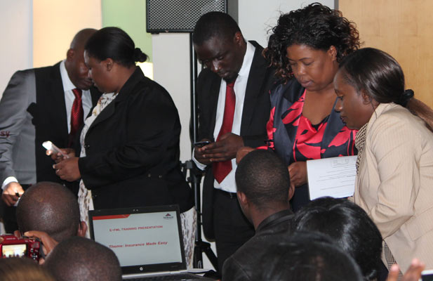 Invited guests testing the new e-FML mobile insurance product from First Mutual Life