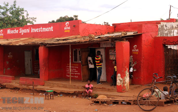 The makeshift movie house at a Likuni shopping center, Lilongwe, Malawi. The guys there are looking at movie posters. Yes, that's airtel money there. I should have asked if they are a mobile money agent or just a billboard!