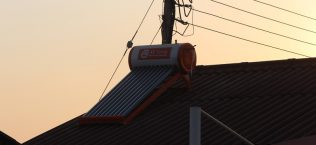 Geyser on roof, electricity pole