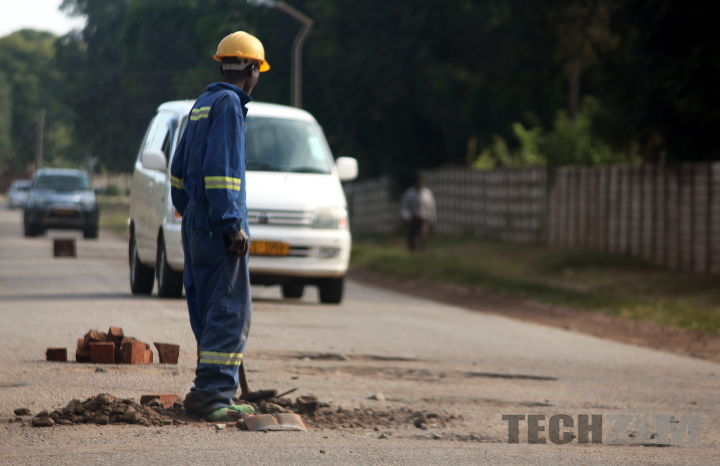 Man fixing road voluntarily in Harare