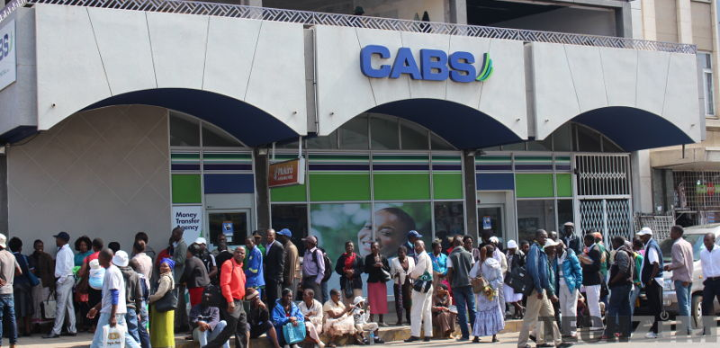 People queue up at a CABS branch
