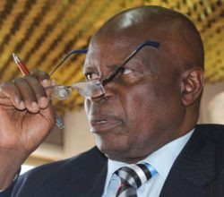 Chinamasa wearing specs