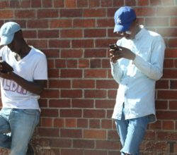 Two men holding phones, on social media