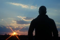 Silhouette of a man on a mountain