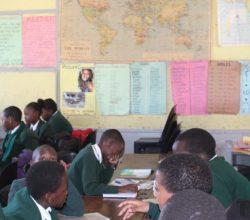 School children in classroom taking exam