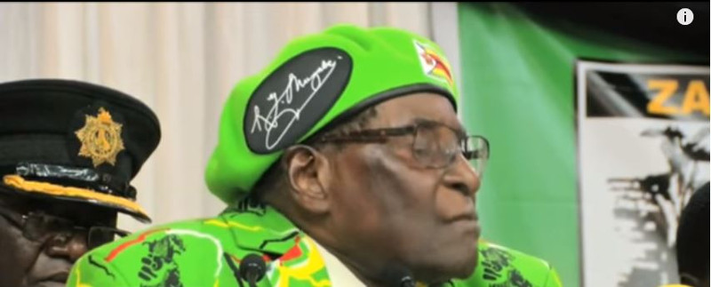 Robert Mugabe in green head gear