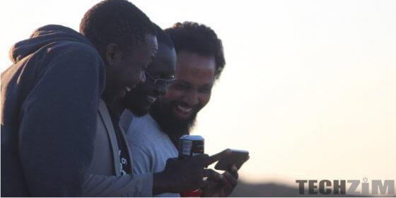 Men staring at a phone