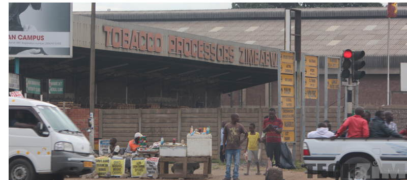 People outside the Zimbabwe Tobacco processors building
