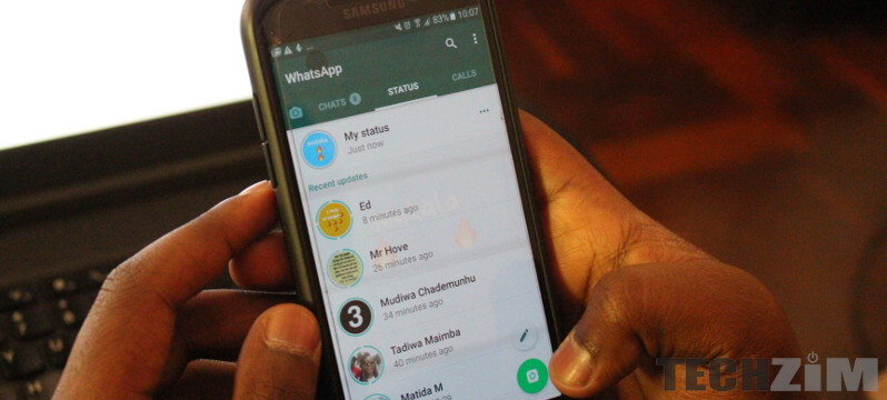 A phone with WhatsApp Messenger opened