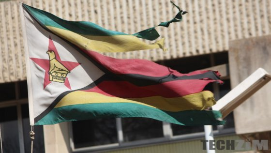 Torn Zimbabwe flag flying