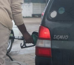 Man filling a car up with fuel