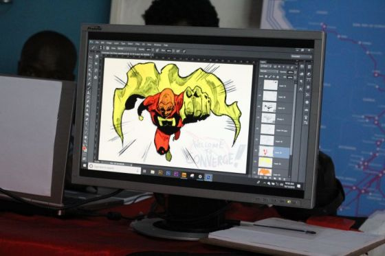 computer with an nimation drawing of a superhero